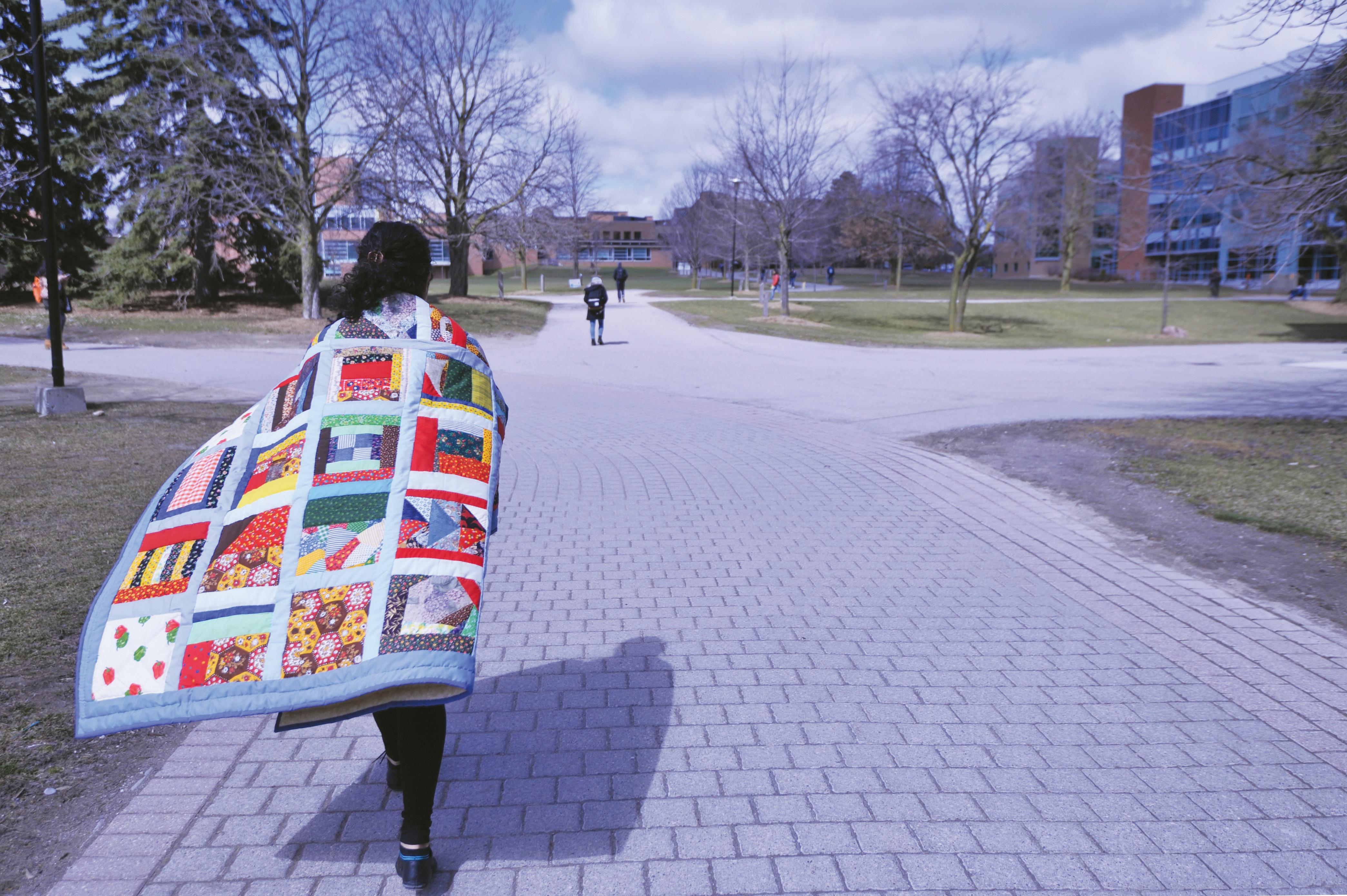 Student with UW Cares quilt